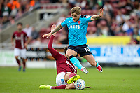 Fleetwood Town's Conor McAleny competing with Northampton Town's Matt Crooks <br /> <br /> Photographer Andrew Kearns/CameraSport<br /> <br /> The EFL Sky Bet League One - Northampton Town v Fleetwood Town - Saturday August 12th 2017 - Sixfields Stadium - Northampton<br /> <br /> World Copyright &copy; 2017 CameraSport. All rights reserved. 43 Linden Ave. Countesthorpe. Leicester. England. LE8 5PG - Tel: +44 (0) 116 277 4147 - admin@camerasport.com - www.camerasport.com