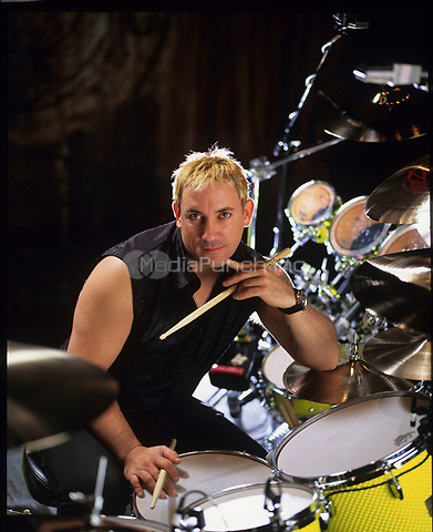 Portraits of Smashing Pumpkins drummer Jimmy Chamberlin photographed at their rehearsal space on Elston Ave. in Chicago, Illinois.<br /> December 20, 2000. <br /> &copy; Gene Ambo / MediaPunch **NO UK or Japan***