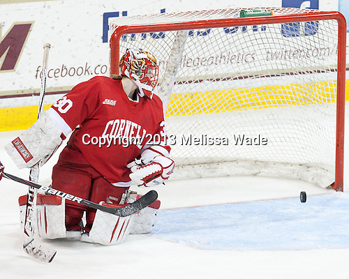 Lauren Slebodnick (Cornell - 30) watches as Field's shot heads back out of the net. - The Boston College Eagles defeated the visiting Cornell University Big Red 4-3 (OT) on Sunday, January 11, 2012, at Kelley Rink in Conte Forum in Chestnut Hill, Massachusetts.