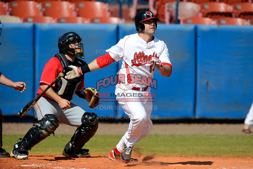 Illinois State Redbirds outfielder Eric Aguilera (33) at bat in front of catcher Mike Bennett during a game against the Fairfield Stangs at Chain of Lakes Stadium on March 10, 2013 in Winter Haven, Florida.  llinois State defeated Fairfield 4-2.  (Mike Janes/Four Seam Images)