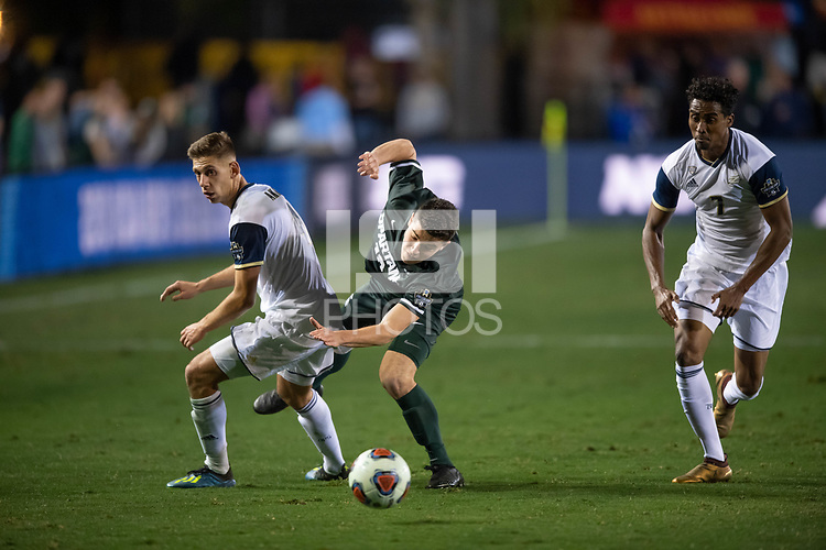 Santa Barbara, CA - Friday, December 7, 2018:  Akron men's soccer defeated Michigan State 5-1 in a semi-final match in the 2018 College Cup.  Michigan State's Michael Miller and Akron defenders.