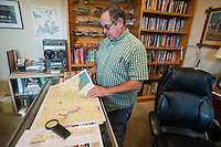 NWA Democrat-Gazette/ANTHONY REYES • @NWATONYR<br /> James Crownover looks over some maps Thursday, Sept. 24, 2015 he uses while writing his book at his home in Elm Springs. Crownover won two Spur awards for his first published western novel.