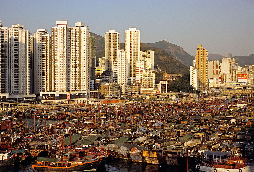 Hong Kong. Aberdeen. Typhoon shelter and high rise apartment blocks. China..