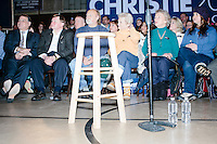People listen as Republican presidential candidate and New Jersey governor Chris Christie speaks at his final New Hampshire town hall of the primary election at the St. George Greek Orthodox Cathedral in Manchester, New Hampshire, on Mon., Feb., 8, 2016.