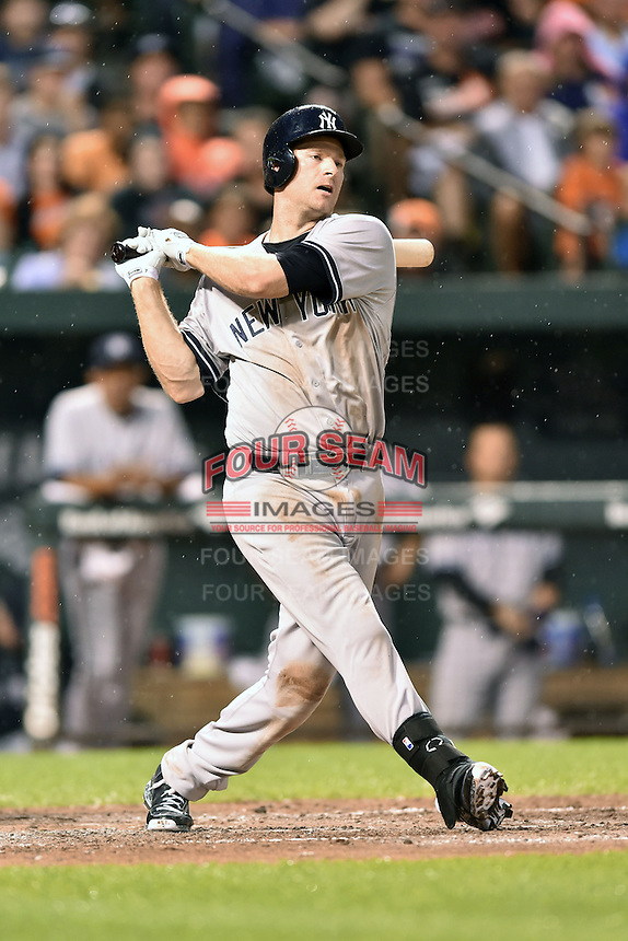 New York Yankees third baseman Chase Headly #14 swings at a pitch during a game against the Baltimore Orioles at Oriole Park at Camden Yards August 11, 2014 in Baltimore, Maryland. The Orioles defeated the Yankees 11-3. (Tony Farlow/Four Seam Images)