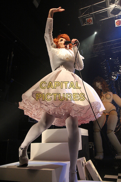 PALOMA FAITH.Performs Live in concert, Koko Camden, London, England, UK, .23rd November 2009..music gig on stage full length white ruffle collar dress neck costume microphone singing tights platform shoes mary janes steps arm raised .CAP/MAR.© Martin Harris/Capital Pictures.