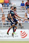 12 June 2013: Carolina's Austin Da Luz (left) and Chivas' Carlos Borja (behind) challenge for a header. The North American Soccer League's Carolina RailHawks hosted Major League Soccer's CD Chivas USA at WakeMed Stadium in Cary, NC in a 2013 Lamar Hunt U.S. Open Cup fourth round game. Carolina won the game 3-1 after extra time.