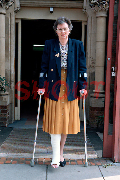 Patient leaving hospital after having a plaster cast fitted to her leg. This image may only be used to portray the subject in a positive manner..©shoutpictures.com..john@shoutpictures.com