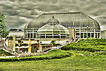 Phipps Conservatory in Pittsburgh PA under a cloudy sky.