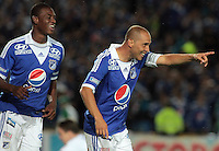 BOGOTÁ -COLOMBIA, 15-06-2013. Mayer Candelo de Millonarios celebra un gol  en contra de Once Caldas durante partido de los cuadrangulares finales F1 de la Liga Postobón 2013-1 jugado en el estadio el Campín de la ciudad de Bogotá./ Mayer Candelo of Millonarios celebrates a goal against Once Caldas during match of the final quadrangular 1th date of Postobon  League 2013-1 at El Campin stadium in Bogotá city. Photo: VizzorImage/STR