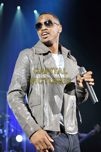 TREY SONGZ (Tremaine Aldon Neverson).Performing live in concert at HMV Hammersmith Apollo, London, England, UK, April 26th 2011..music gig on stage half length sunglasses leather jacket grey gray microphone .CAP/MAR.© Martin Harris/Capital Pictures.