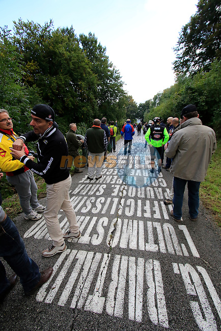Fans await the riders on the 30% gradient climb of Colma di Sormano during the last classic of the season Il Lombardia 2015 running 245km from Bergamo to Como, Italy. 4th October 2015.<br /> Picture: Eoin Clarke | Newsfile