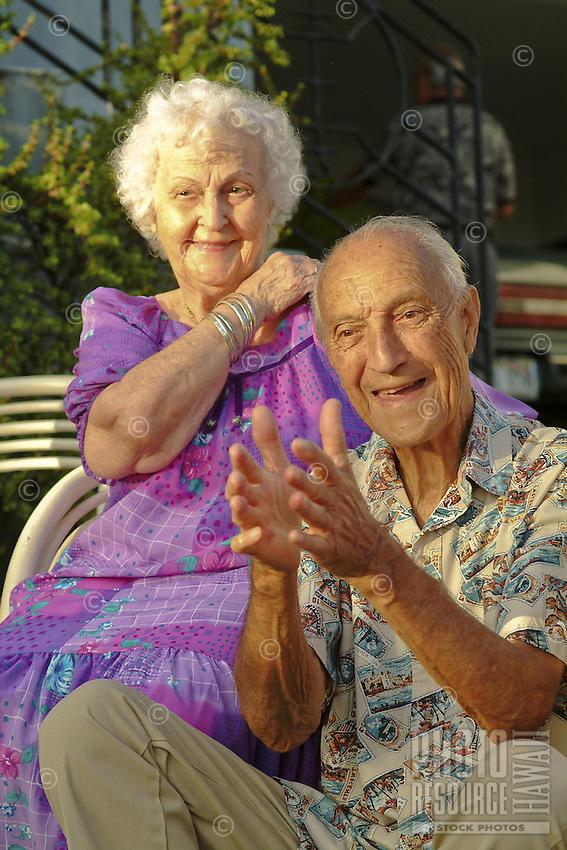 Happy local elder couple, the Bertlemann Family portrait; Papakolea, Oahu..MODEL RELEASED IMAGE