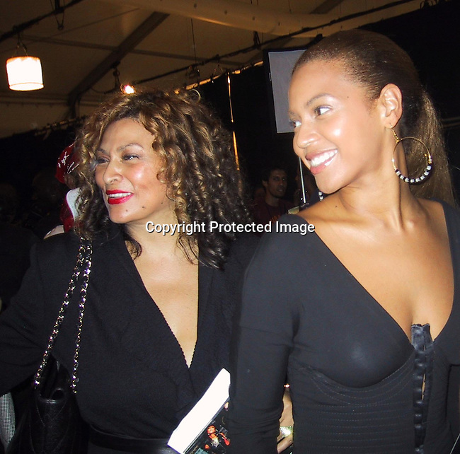 Tina &amp; Beyonce Knowles<br />Baby Phat Fashion Show Front Row &amp; backstage<br />Gertrude Tent, Bryant Park<br />New York City, NY, USA<br />Saturday, September, 13, 2003 <br />Photo By Celebrityvibe.com/Photovibe.com