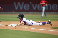 Zach Remillard (7) of the Winston-Salem Rayados slides head-first into third base after hitting a triple against the Potomac Nationals at BB&T Ballpark on August 12, 2018 in Winston-Salem, North Carolina. The Rayados defeated the Nationals 6-3. (Brian Westerholt/Four Seam Images)