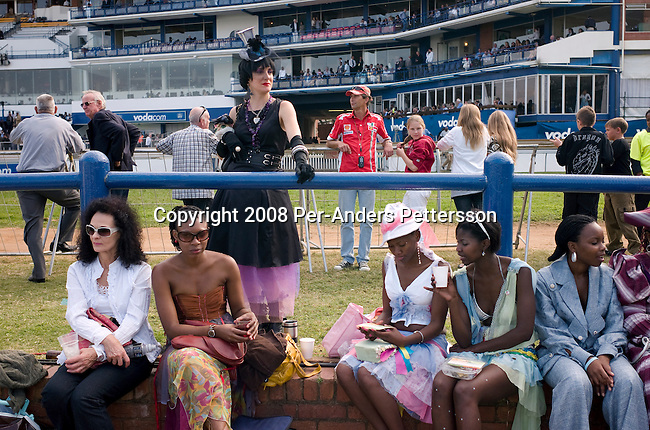 DURBAN, SOUTH AFRICA - JULY 5: South African's attend the annual Durban July horse race on July 5, 2008, in Durban, South Africa. It?s the biggest social event of the winter season and people from all over the country come to dress up and party. Many of South Africa?s big companies host lavish parties and receptions for VIP clients. The country has a growing number of black middle class and wealthy people, enjoying the spoils of democracy in the country. (Photo by: Per-Anders Pettersson/Getty Images)..