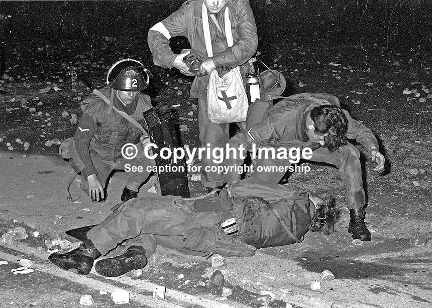 Colleagues attend a soldier injured in a skirmish with rioters at the William Street-Rossville Street interface with the Bogside, Londonderry, N Ireland, UK. Exact date not known. 197000000323.<br />