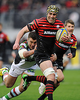 20130324 Copyright onEdition 2013©.Free for editorial use image, please credit: onEdition..Kelly Brown of Saracens is tackled by Nick Easter of Harlequins during the Premiership Rugby match between Saracens and Harlequins at Allianz Park on Sunday 24th March 2013 (Photo by Rob Munro)..For press contacts contact: Sam Feasey at brandRapport on M: +44 (0)7717 757114 E: SFeasey@brand-rapport.com..If you require a higher resolution image or you have any other onEdition photographic enquiries, please contact onEdition on 0845 900 2 900 or email info@onEdition.com.This image is copyright onEdition 2013©..This image has been supplied by onEdition and must be credited onEdition. The author is asserting his full Moral rights in relation to the publication of this image. Rights for onward transmission of any image or file is not granted or implied. Changing or deleting Copyright information is illegal as specified in the Copyright, Design and Patents Act 1988. If you are in any way unsure of your right to publish this image please contact onEdition on 0845 900 2 900 or email info@onEdition.com