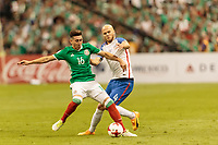 Mexico City, Mexico - Sunday June 11, 2017: Héctor Herrera, Michael Bradley during a 2018 FIFA World Cup Qualifying Final Round match with both men's national teams of the United States (USA) and Mexico (MEX) playing to a 1-1 draw at Azteca Stadium.