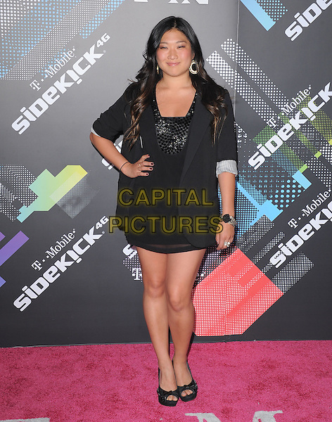 JENNA USHKOWITZ.at The T-Mobile Sidekick 4G Launch Party held at a private lot in Beverly Hills, California, USA, April 20th 2011..full length dress hand on hip blazer open toe shoes black jacket .CAP/RKE/DVS.©DVS/RockinExposures/Capital Pictures.