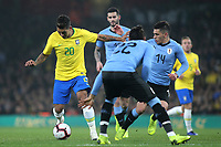 Roberto Firmino of Brazil takes on the Uruguay defence  during Brazil vs Uruguay, International Friendly Match Football at the Emirates Stadium on 16th November 2018