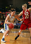 BROOKINGS, SD - FEBRUARY 2:  Steph Paluch #15 from South Dakota State drives against Nicole Seekamp #35 from the University of South Dakota in the first half of their game Sunday afternoon at Frost Arena in Brookings. (Photo by Dave Eggen/Inertia)