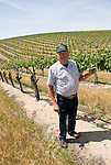 California, San Luis Obispo County: At Eberle Winery and vineyards in Paso Robles, noted for red wines. Model released..Photo caluis132-70799..Photo copyright Lee Foster, www.fostertravel.com, 510-549-2202, lee@fostertravel.com
