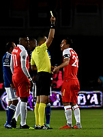 BOGOTÁ - COLOMBIA, 20-01-2019: Edilson Ariza (Cent.) árbitro, muestra tarjeta Amarilla a Luis Seijas (Der.), jugador de Independiente Santa Fe, durante partido entre Independiente Santa Fe y Millonarios, por el Torneo Fox Sports 2019, jugado en el estadio Nemesio Camacho El Campin de la ciudad de Bogotá. / Edilson Ariza (C) referee, shows yellow card to Luis Seijas (R) player of Independiente Santa Fe, during a match between Independiente Santa Fe and Millonarios, for the Fox Sports Tournament 2019, played at the Nemesio Camacho El Campin stadium in the city of Bogota. Photo: VizzorImage / Luis Ramírez / Staff.