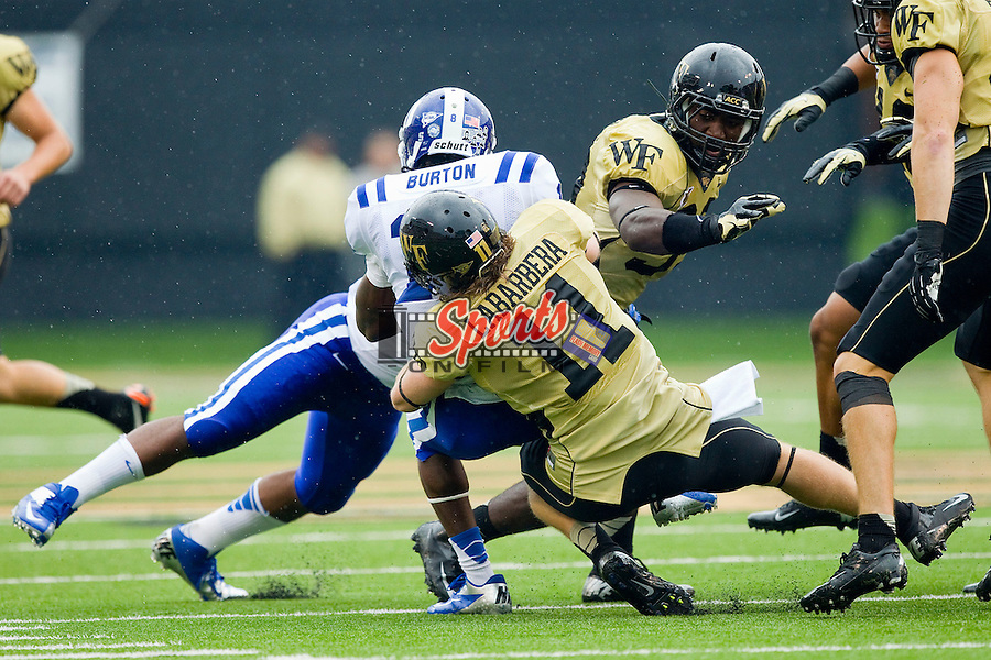 Joe LaBarbera (11) of the Wake Forest Demon Deacons tackles Tim Burton (11) of the Duke Blue Devils at BB&T Field on September 29, 2012 in Winston-Salem, North Carolina.  The Blue Devils defeated the Demon Deacons 34-27.  (Brian Westerholt/Sports On Film)