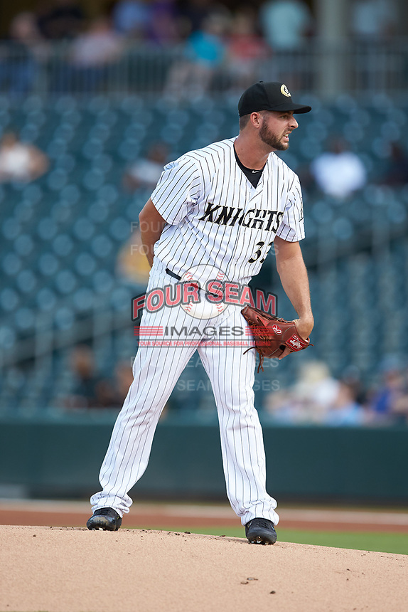 Charlotte Knights starting pitcher Donny Roach (33) looks to his catcher for the sign against the Scranton/Wilkes-Barre RailRiders at BB&T BallPark on August 14, 2019 in Charlotte, North Carolina. The Knights defeated the RailRiders 13-12 in ten innings. (Brian Westerholt/Four Seam Images)