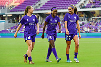 Orlando, FL - Saturday March 24, 2018: Orlando Pride forward Danica Evans (8), Orlando Pride forward Chioma Ubagagu (6) and Orlando Pride midfielder Dani Weatherholt (17) walk to the locker room after warming up prior to a regular season National Women's Soccer League (NWSL) match between the Orlando Pride and the Utah Royals FC at Orlando City Stadium. The game ended in a 1-1 draw.