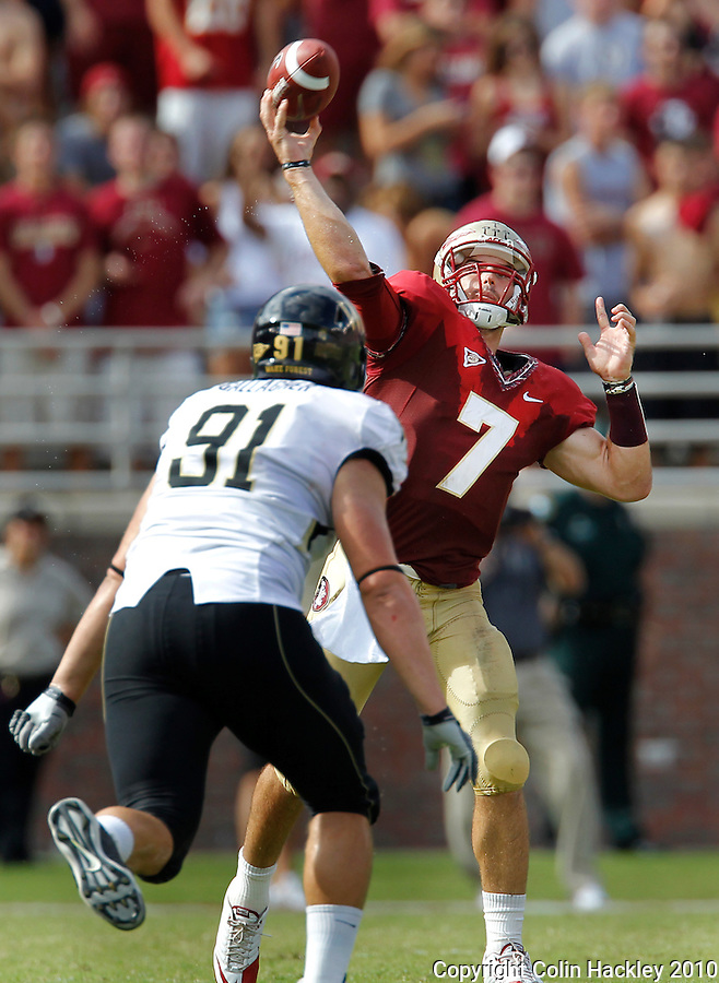TALLAHASSEE, FL 9/25/10-FSU-WF FB10 CH-Florida State's Christian Ponder throws under pressure from Wake Forest's John Gallagher during first half action Saturday at Doak Campbell Stadium in Tallahassee. .COLIN HACKLEY PHOTO
