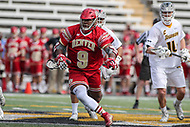 Towson, MD - March 25, 2017: Denver Pioneers Trevor Baptiste (9) wins the faceoff during game between Towson and Denver at  Minnegan Field at Johnny Unitas Stadium  in Towson, MD. March 25, 2017.  (Photo by Elliott Brown/Media Images International)