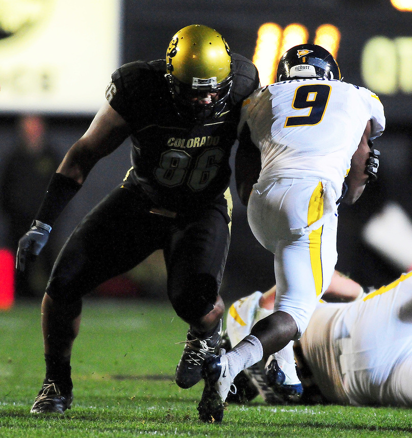18 September 08: Colorado defensive tackle George Hypolits lines up to tackle West Virginia wide receiver Jock Sanders. The Colorado Buffaloes defeated the West Virginia Mountaineers 17-14 in overtime at Folsom Field in Boulder, Colorado. For Editorial Use Only.