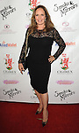 Catherine Bach arriving at Brent Shapiro Foundation Summer Spectacular Under The Stars, held at a private residence in Beverly Hills, CA. September 13, 2014.