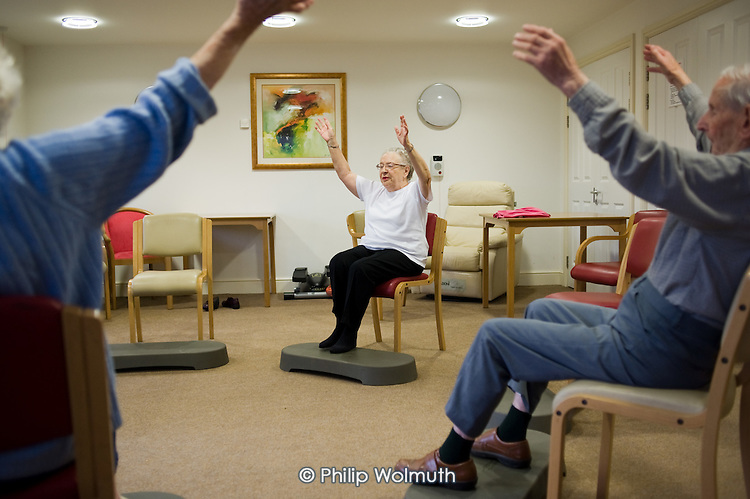 Chair-based exercise class at Esk Moors Lodge, Castleton, North Yorkshire, a sheltered housing scheme and 'extra care' centre run by Esk Moors Caring.