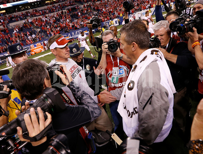 Ohio State Buckeyes head coach Urban Meyer  shakes hands with Wisconsin Badgers head coach Gary Andersen following Ohio State's 59-0 win over the Wisconsin Badgers in the Big Ten Championship game at Lucas Oil Stadium in Indianapolis on Dec. 6, 2014. (Adam Cairns / The Columbus Dispatch)