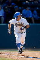 Pat Valaika #10 of the UCLA Bruins runs to first base during a game against the Oklahoma Sooners at Jackie Robinson Stadium on March 9, 2013 in Los Angeles, California. (Larry Goren/Four Seam Images)
