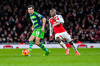 Jack Cork of Swansea City  ( right ) in action during the Barclays Premier League match between Arsenal and Swansea City at the Emirates Stadium, London, UK, Wednesday 02 March 2016