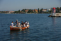 Zadar, Croatia. 26.05.2018. A boatman rows tourists across the harbour in Zadar, Croatia. Photograph © Jane Hobson.