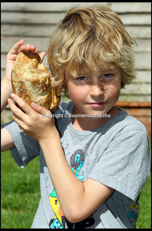 BNPS.co.uk (01202 558833)Pic: BournemouthEcho/BNPS <br /> <br /> Eight year old Charlie Naysmith with the piece of ambergris that he found on the beach at Hengistbury. Ambergris is whale vomit and is worth thousands of pounds.