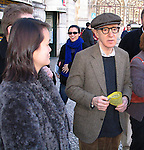 *** EXCLUSIVE Coverage ***.Woody Allen with his wife Soon-Yi Previn.taking a walk seeing the sights of Lisbon, Portugal..Debember 30, 2004.( eating hot chestnuts ).© Walter McBride /