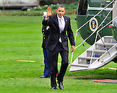 Washington, D.C. - March 25, 2010 -- United States President Barack Obama waves to the photographers as he arrives on the South Lawn of the White House aboard Marine 1 after speaking in Iowa City, Iowa on the benefits of his health care reform bill which was signed earlier in the week on Thursday, March 25, 2010..Credit: Ron Sachs / Pool via CNP