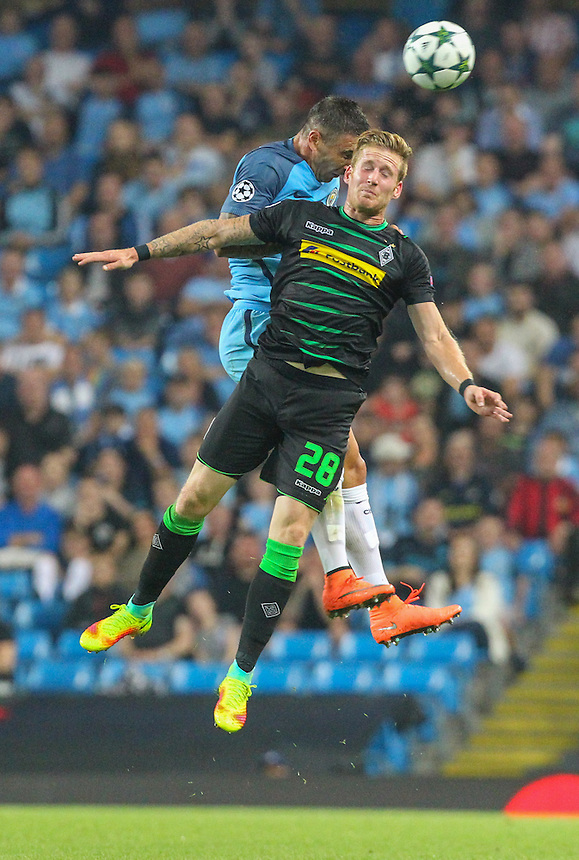 Borussia Monchengladbach's Andre Hahn and Manchester City's Aleksandar Kolarov compete in the air<br /> <br /> Photographer Alex Dodd/CameraSport<br /> <br /> UEFA Champions League - Group C - Manchester City v Borussia Monchengladbach - Tuesday 13 September 2016 -  Etihad Stadium - Manchester<br />  <br /> World Copyright &copy; 2016 CameraSport. All rights reserved. 43 Linden Ave. Countesthorpe. Leicester. England. LE8 5PG - Tel: +44 (0) 116 277 4147 - admin@camerasport.com - www.camerasport.com