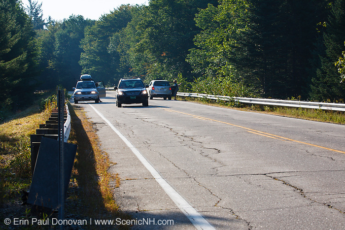 Tourists pull off along the Kancamagus Highway (Route 112) to view a moose on the side of the road in the White Mountains, New Hampshire USA