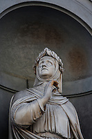 Detail of statue of Petrarch, 16th century, on the facade of the Uffizi Gallery, Florence, Tuscany, Italy, pictured on June 10, 2007, in the morning. This statue of Francesco Petrarca, 1304-74, poet and scholar who invented the Petrarchian sonnet, is one of a gallery of sculptures of eminent Italian men whose works in the arts and sciences are remembered today. Florence, capital of Tuscany, is world famous for its Renaissance art and architecture. Its historical centre was declared a UNESCO World Heritage Site in 1982. Picture by Manuel Cohen