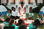 United States first lady Michelle Obama pretends to warm herself over a 'fire' made from battery-powered lanterns as she and President Barack Obama host a group of Girl Scouts from across the country for a campout on the South Lawn of the White House June 30, 2015 in Washington, DC.  The first family hosted the event as part of the first lady's Let's Move! Outside initiative and for Girl Scouts to earn the new Girls' Choice Outdoor badge.  <br /> Credit: Chip Somodevilla / Pool via CNP