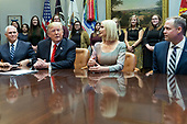 United States President Donald J. Trump congratulates NASA astronauts Jessica Meir and Christina Koch from the White House in Washington, DC after they conducted the first all-female spacewalk outside of the International Space Station on Friday, October 18, 2019.  With Trump, from left,  United States Vice President Mike Pence, First Daughter and Advisor to the President Ivanka Trump and Administrator, National Aeronautics and Space Administration (NASA) Jim Bridenstine.<br /> Credit: Chris Kleponis / Pool via CNP