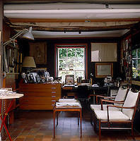 In the office adjacent to the studio a plan chest is filled with family photographs mostly taken by Lord Snowdon