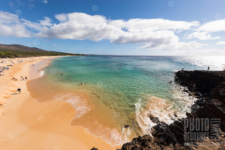 Beachgoers enjoy a clear day at Makena Beach, Maui.